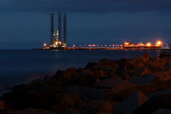 Derrick ago. Drilling rig in the morning Stock Image
