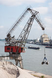 Derrick and barge at Rhine River Royalty Free Stock Images
