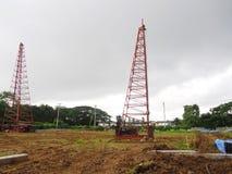 Derrick crane at construction work site Stock Images