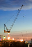 Derrick cranes at construction site Royalty Free Stock Photo