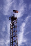 Derrick Old Glory. The flag is almost always flown on all rigs Stock Photos