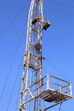 Derrick of Small Workover Rig on Sunny Day Stock Image