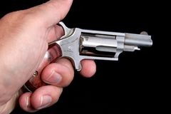 Derringer in hand Royalty Free Stock Photography