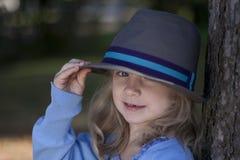 Derrubando seu chapéu Imagem de Stock Royalty Free