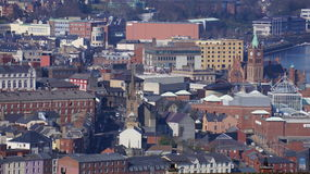 Derry - Londonderry, Northern Ireland. A view of the City of Derry - Londonderry in Northern Ireland with the Guildhall clock tower visible at the right Stock Photo