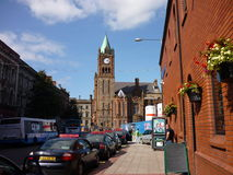 Derry, Northern Ireland. A street in Derry with the view the Guildhall stock photo