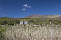 Derrynane House as seen from the grass covered dunes Stock Image