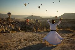 Dervish doing the retual in love valley of Cappadocia with ballo royalty free stock photography