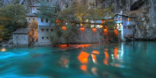 Dervish house, Blagaj, Bosnia and Herzegovina - panorama, night scene royalty free stock image