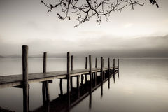 Derwent Jetty. A landing jetty at Derwent water on a misty Autumn morning Royalty Free Stock Photo