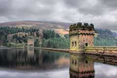 Derwent reservoir stone dam breakwater under a cloudy sky Royalty Free Stock Image