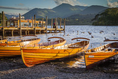 Derwentwater in Lake District. Rowing boats at Derwentwater in the evening light Royalty Free Stock Photography