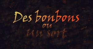 Des bonbons uo un rodzaj & x28; Sztuczka x29 lub Treat&; Francuski tekst rozpuszcza w pył od dna Obrazy Royalty Free