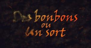 Des bonbons uo un rodzaj & x28; Sztuczka x29 lub Treat&; Francuski tekst rozpuszcza w pył od lewicy Fotografia Stock