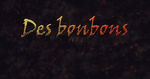 Des bonbons uo un sort (Trick or Treat) French text dissolving into dust from bottom stock footage