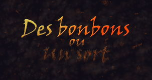 Des bonbons uo un sort (Trick or Treat) French text dissolving into dust from bottom Royalty Free Stock Images