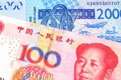 Des cent notes chinoise de yuans avec la facture d'Afrique occidentale de franc images stock