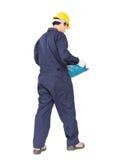 Des Griffhod oder -maschinenhälfte des jungen Arbeitnehmers geformter Korb Stockfoto