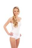 Des jeunes et un femme blond d'ajustement dans la lingerie blanche Photos stock