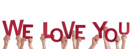 Des mains se tenant nous vous aimons Image libre de droits