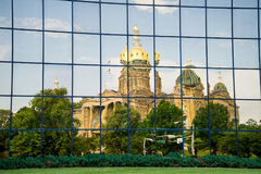Des Moines Iowa State Capitol. Beautiful historical Des Moines Iowa State Capitol reflected in glass office building windows stock photo