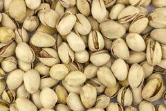 Des pistaches d'écrous ne sont pas nettoyées Fond, texture image stock