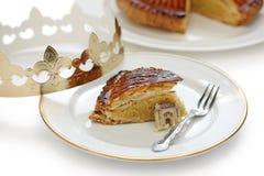 DES rois, gâteau de Galette de roi images libres de droits