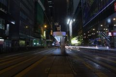 Des Voeux Road Central by night in HK Stock Image
