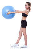 Des in voller Länge junge Frau Sports, die Übungen tut Lizenzfreies Stockfoto