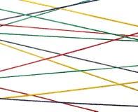 Des Zeichenkette-Netzkabels der Wollen strickender bunter Hintergrund Stockfotografie