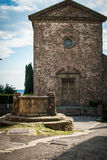 Desacred church with well in Tuscany. Commenda, romanic descared church in the heart of Chianti. Volpaia, Tuscany Royalty Free Stock Photos