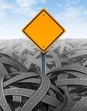 Desafia o símbolo com sinal de estrada em branco Fotos de Stock Royalty Free