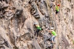 Team Of Climbers Climbing A Rock Wall Royalty Free Stock Photos