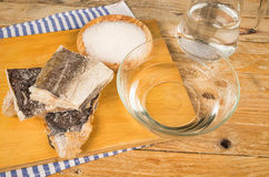 Desalting cod. Several pieces of dried cod being desalted in fresh water stock photography