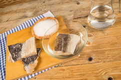 Desalting cod. Several pieces of dried cod being desalted in fresh water royalty free stock images