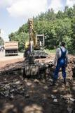 Desarrollo del excavador del hoyo Foto de archivo