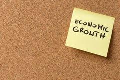 Desarrollo económico pegajoso amarillo de la nota/del poste Imágenes de archivo libres de regalías