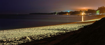 Desaru beach at night. Sea, sand and cloudy sky with bolt and th Stock Photography