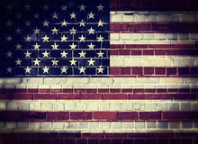 Desaturated America flag on a brick wall Stock Images