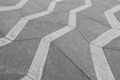 A desaturated and distorted photograph of a patterned sidewalk i royalty free stock photography