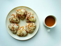 Desayuno con café y galletas Imagenes de archivo