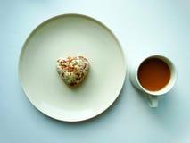 Desayuno con café y galletas Imagen de archivo libre de regalías