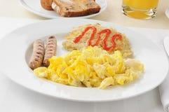 Desayuno de la salchicha y del huevo Imagen de archivo libre de regalías
