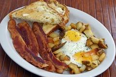 Desayuno de tocino y del huevo Imagenes de archivo