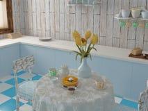Desayuno en cocina azul con los tulipanes Imagen de archivo
