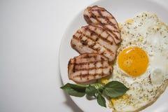 Desayuno frito con los huevos y el cerdo Foto de archivo libre de regalías