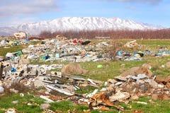 Descarga da cidade do lixo Imagem de Stock