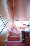 Descend down angular stairway in double-decker bus. Descend down angular stairway in English double-decker bus Stock Image