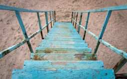 Descend down the old blue staircase.  Stock Photography