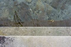 Descend concrete stairs into the water, concept photography. Descend grey concrete stairs into the water, concept photography stock photo